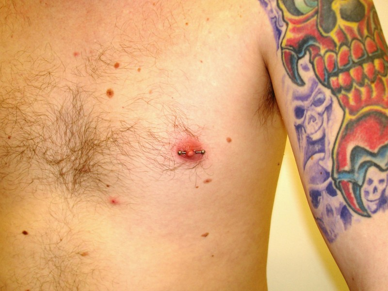 Male nipple behind bars body piercing and tattoo for Men nipple tattoo